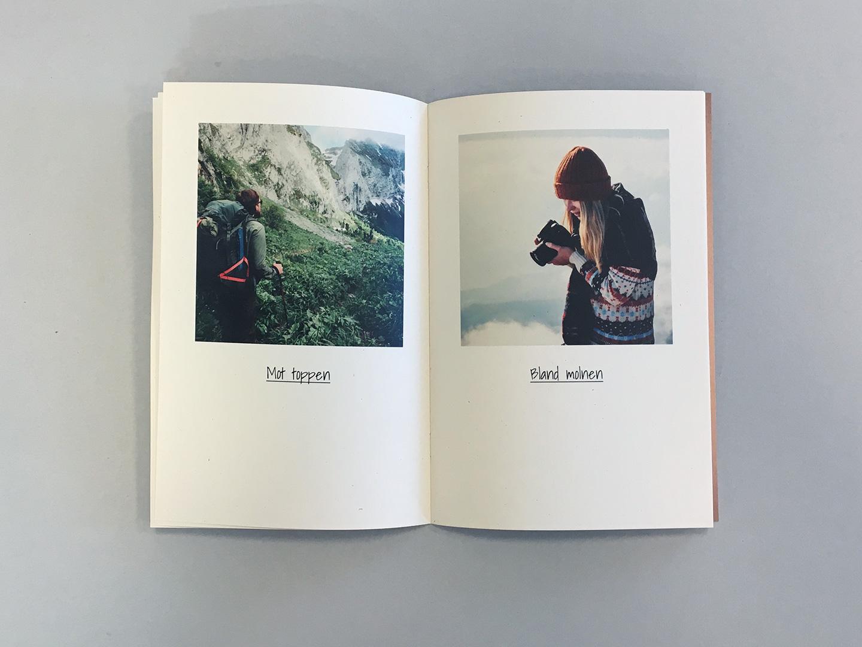 Uppslag av fotobok på naturpapper